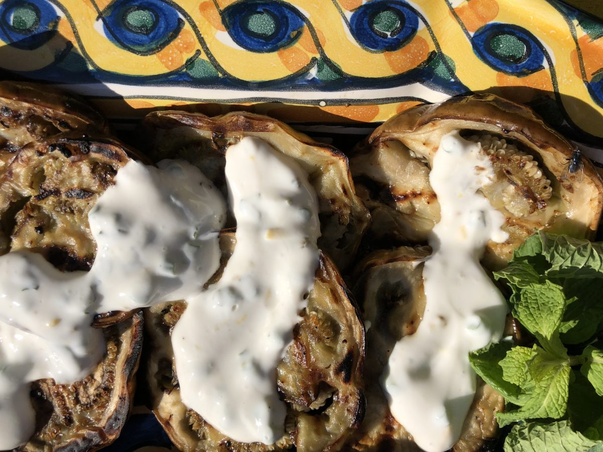 grilled eggplant drizzled with creamy garlic sauce