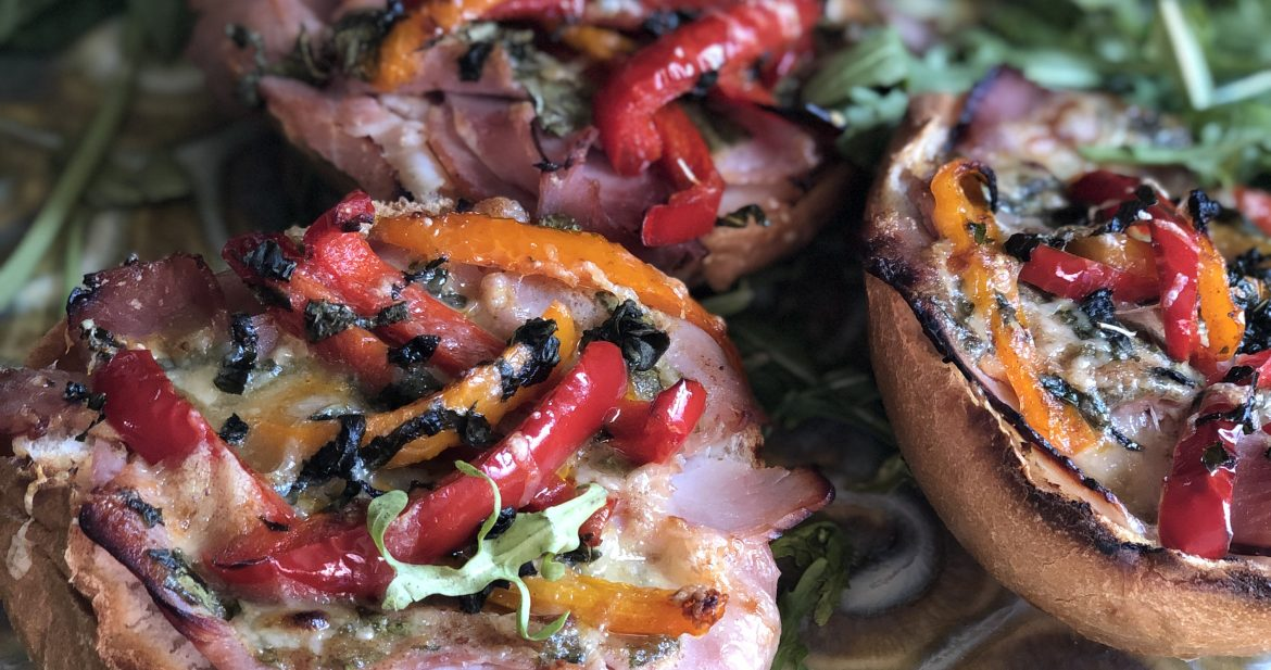 open face ham sandwich with roasted peppers and a mustard basil glaze
