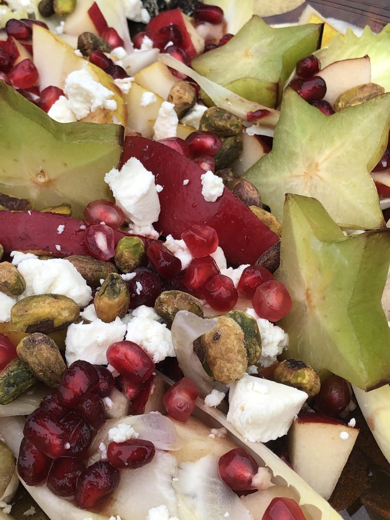 pomegranate, star fruit, and pistachio close up!