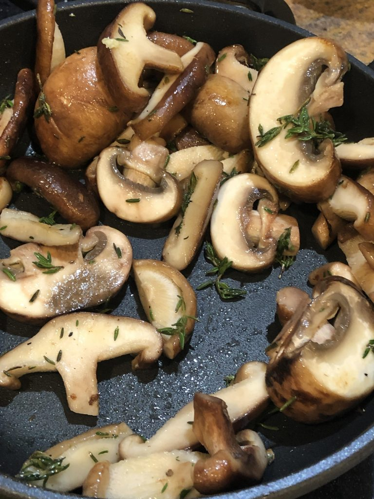 sage and mushrooms in the saute pan